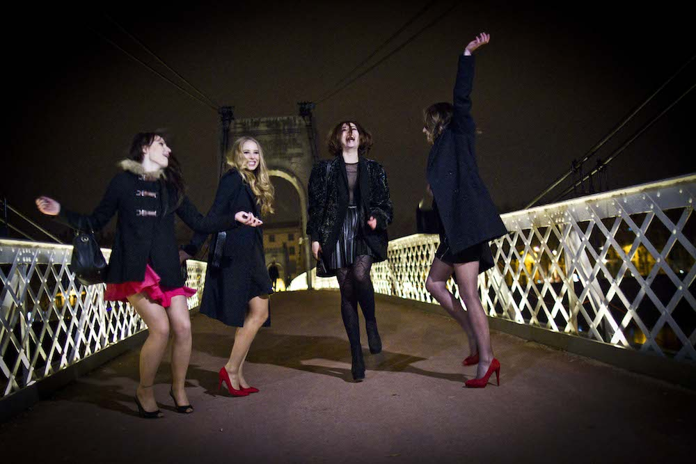 girls dancing on bridge